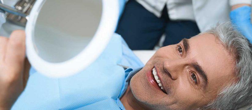 Should I get Dental Implants or Dentures